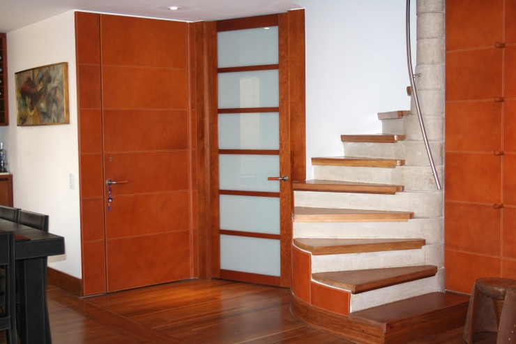 Stairs, wall, door and handle door with natural leather. Handmade stitching with italian thread.