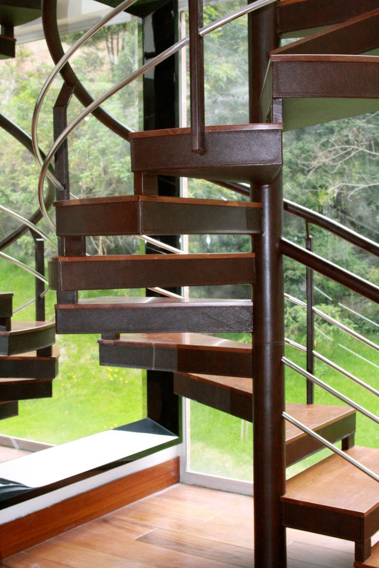 Leather stairs and railing. Handmade stitching with italian thread.